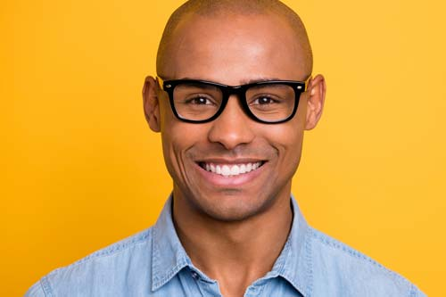 A man smiles, showing the results of general dentistry at Lovett Dental in Kohrville, TX