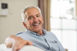 A man smiles happily after receiving specialty dental services in Kohrville, TX