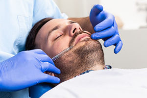 a man receives treatment from a houston sedation dentist