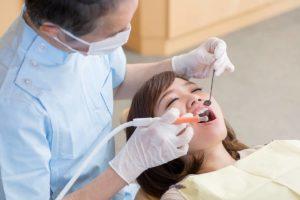 Dentist performing gingivitis treatment