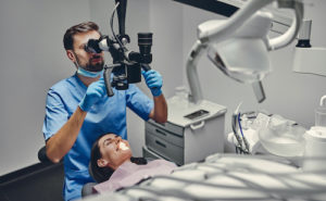 Dr. prepares a patient for a root canal