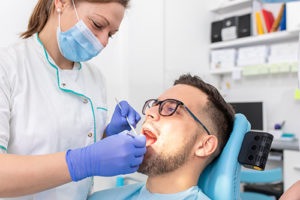 man receives restorative dentistry treatment